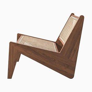Butaca Kangaroo baja de madera y caña tejida de Pierre Jeanneret para Cassina
