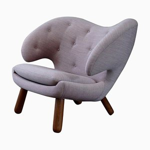 Pelican Chair Fabric with Buttons and Wood by Finn Juhl