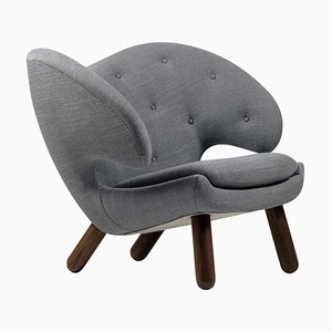 Pelican Chair in Fabric & Wood with Buttons by Finn Juhl