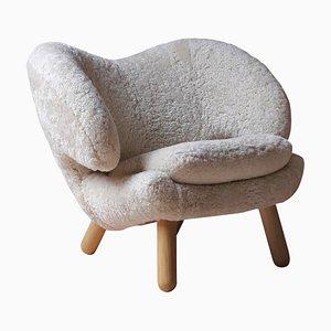 Moonlight Pelican Chair in Skandilock Sheepskin and Wood by Finn Juhl