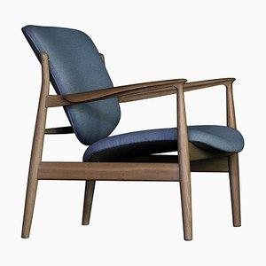 Sedia France in legno e stoffa di Finn Juhl