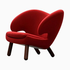 Pelican Stuhl aus rotem Divina und Holz von Finn Juhl
