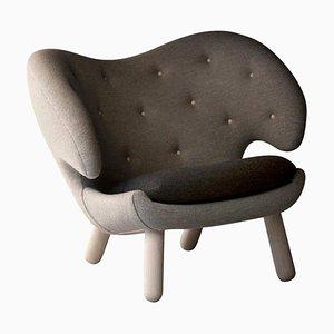 Pelican Chair Fabric and Wood by Finn Juhl