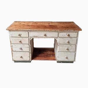 Banco de trabajo o mesa de trabajo vintage en color crema