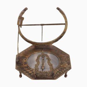 Orologio solare equatoriale con compasso