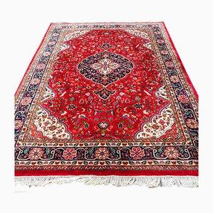 Roter orientalischer Vintage Teppich