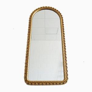 Specchio a forma di arco con cornice dorata