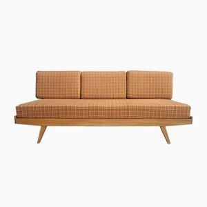 Sofá cama en naranja, años 60