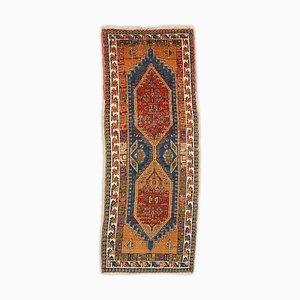 Tappeto Sarab geometrico in terracotta con bordo