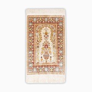 Floraler Hereke Teppich aus reiner Seide in Cremeweiß mit Rand
