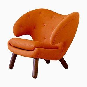 Pelican Stuhl mit orangenem Stoffbezug von Finn Juhl
