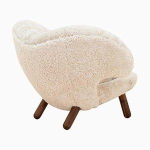 Pelican Chair Skandilock Sheep Moonlight and Wood by Finn Juhl