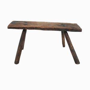 Primitiver Hocker aus Massivholz