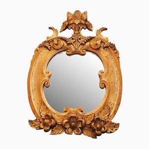 Specchio da parete antico in legno dorato intagliato con frutta e pergamene