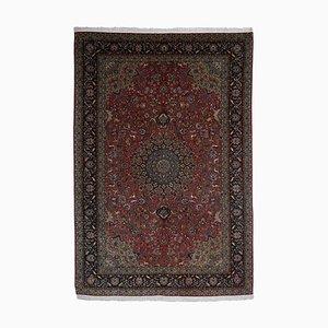 Floraler Teppich in Dunkelrot mit Rand und Medaillon
