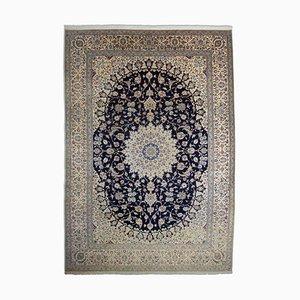 Floraler Teppich in Dunkelblau mit Rand und Medaillon