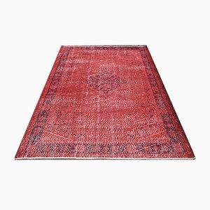 Tappeto Oushak vintage in lana rossa sovratinta con medaglione, Turchia