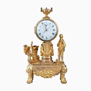 Reloj Luis XVI pequeño de finales del siglo XVIII que representa a un jardinero