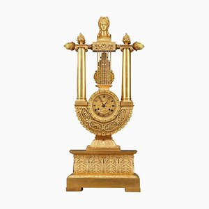Reloj estilo Imperio de bronce dorado