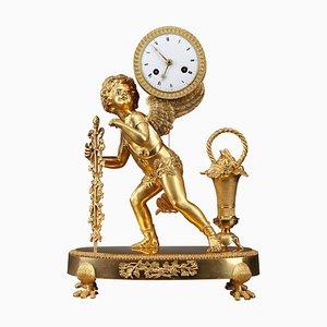Orologio ambulante in bronzo dorato