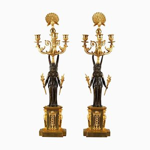 Candelabros Imperio de bronce con tres brazos. Juego de 2