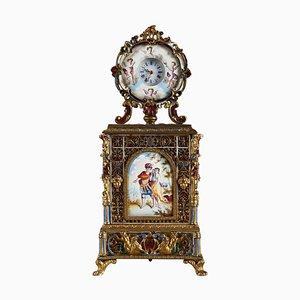 Reloj de mesa vienés de latón dorado y esmaltado, mediados del siglo XIX