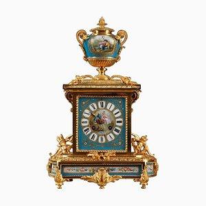 Reloj de mesa de ormolú y porcelana con escenas de Galant