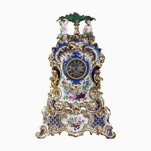 Orologio da camino in porcellana nello stile di Jacob Petit