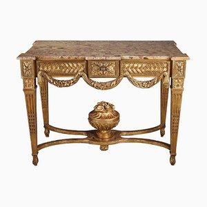 Consola estilo Luis XVI de madera dorada y tallada