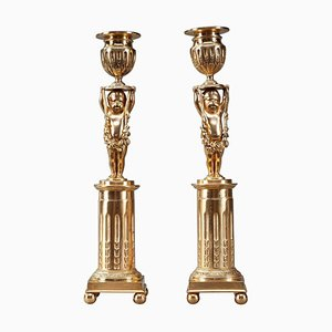 Candeleros Ormolu de bronce con Putti, siglo XIX. Juego de 2