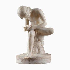 Escultura de alabastro después de Spinario