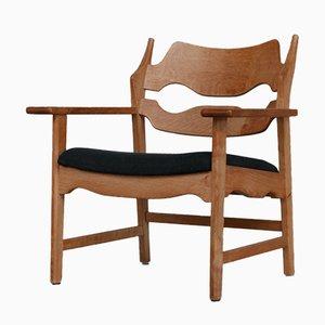 Dänischer Mid-Century Armlehnstuhl aus Eiche von Henning Kjaernulf