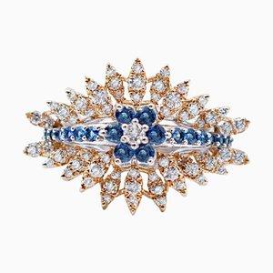 Anello in oro bianco e giallo con zaffiri blu, diamanti e 18 carati