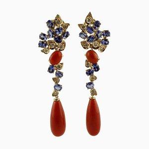 Orecchini a clip con diamanti, tanzaniti e corallo rosso in oro rosa 14 carati