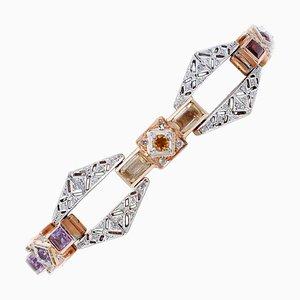 Bracciale in oro 14 carati con diamanti, granati, topazio, ametista