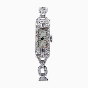 Brazalete o reloj de diamantes y platino