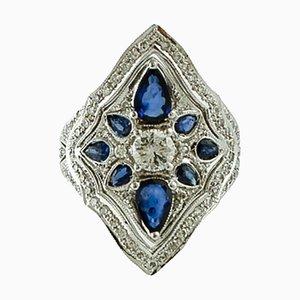 Anello con diamanti, zaffiro blu e oro bianco 14K