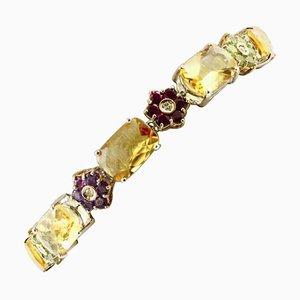Brazalete artesanal de diamantes, zafiros, topacios, amatistas, granate, peridoto y oro blanco de 14 quilates