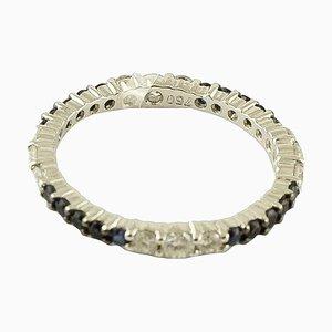 Anello con diamanti, zaffiro blu e oro bianco 18 carati