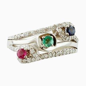 Anello con tre pietre color smeraldo, zaffiro blu, rubino, diamante e 18 carati