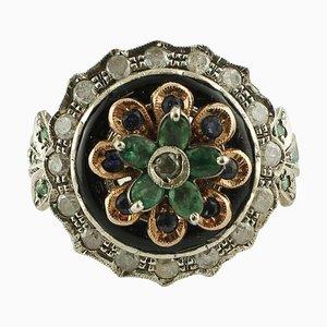Anello con smeraldo, zaffiro blu, diamanti, onice, oro rosa e argento