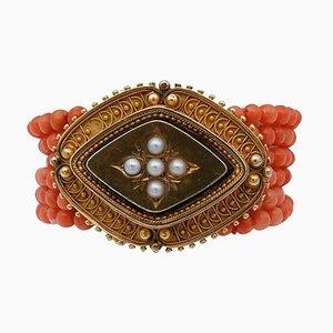 Brazalete de coral, perlas y oro amarillo de 18 kt