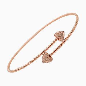 Brazalete de diamantes blancos y oro rosa de 18 quilates con detalle de corazón