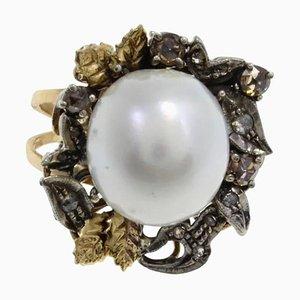 Anello in oro, argento, diamanti e perla australiana