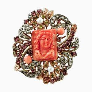 Anello con diamante, corallo rosso inciso, perla, pietra gialla, granato, oro e argento