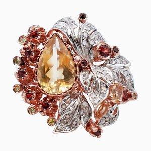 Anillo de topacio, granate, diamante, oro rosa de 14 kt y plata