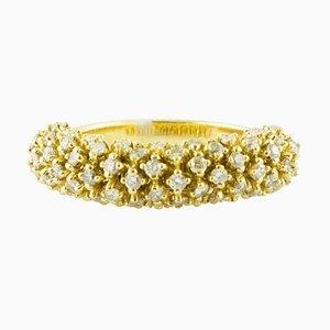 Anello a fascia in oro giallo 18 carati e diamanti