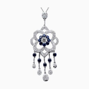 Collier à pendentif diamant, saphir bleu et or blanc 14 carats