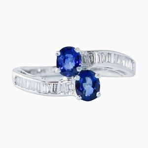 Anello con diamanti, zaffiri e oro bianco 18 Kt