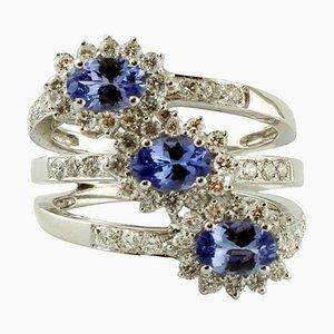 Anello con diamanti, tanzanite e oro bianco 18 carati